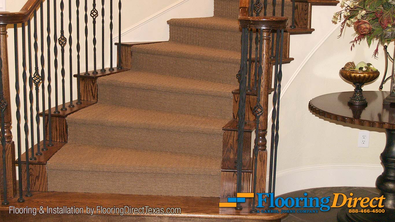 Flooring Direct installers cut under the existing spiral staircase trim and framing for this beautiful carpet installation.