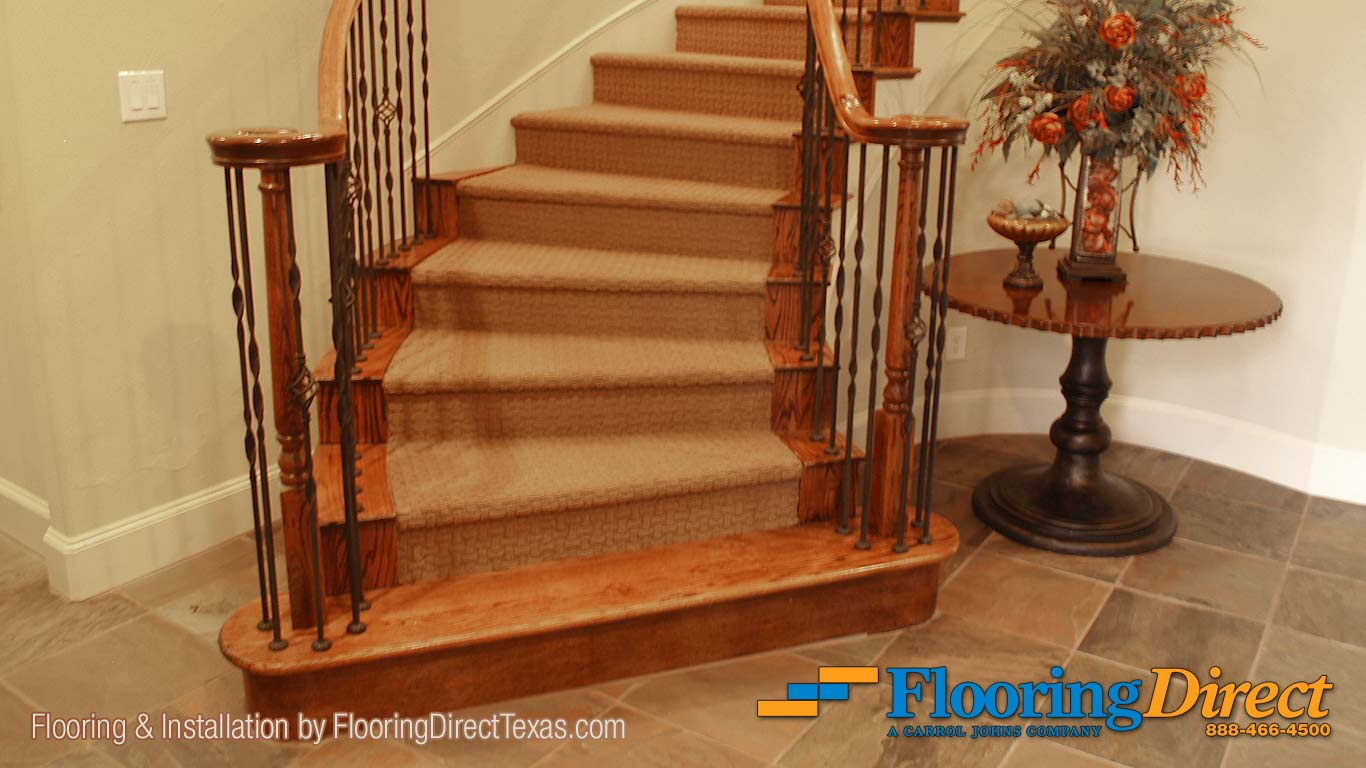 This residential carpet installation by Flooring Direct begins here at this beautiful spiral staircase at the entrance.