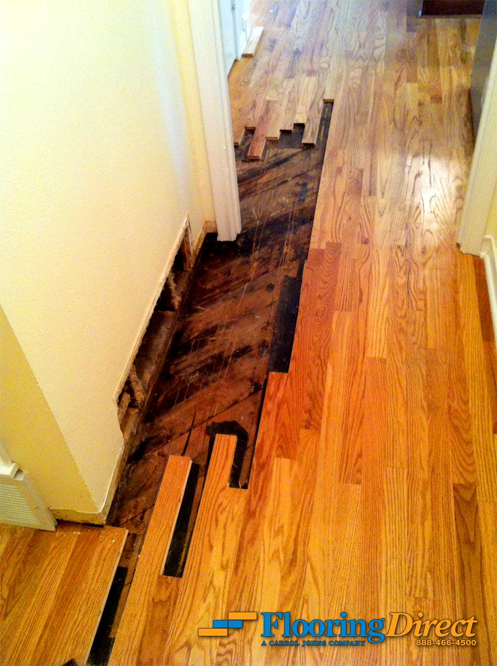 Water Damage: Before - This picture was generously provided to us by the customer of their water-damaged hardwood floor.