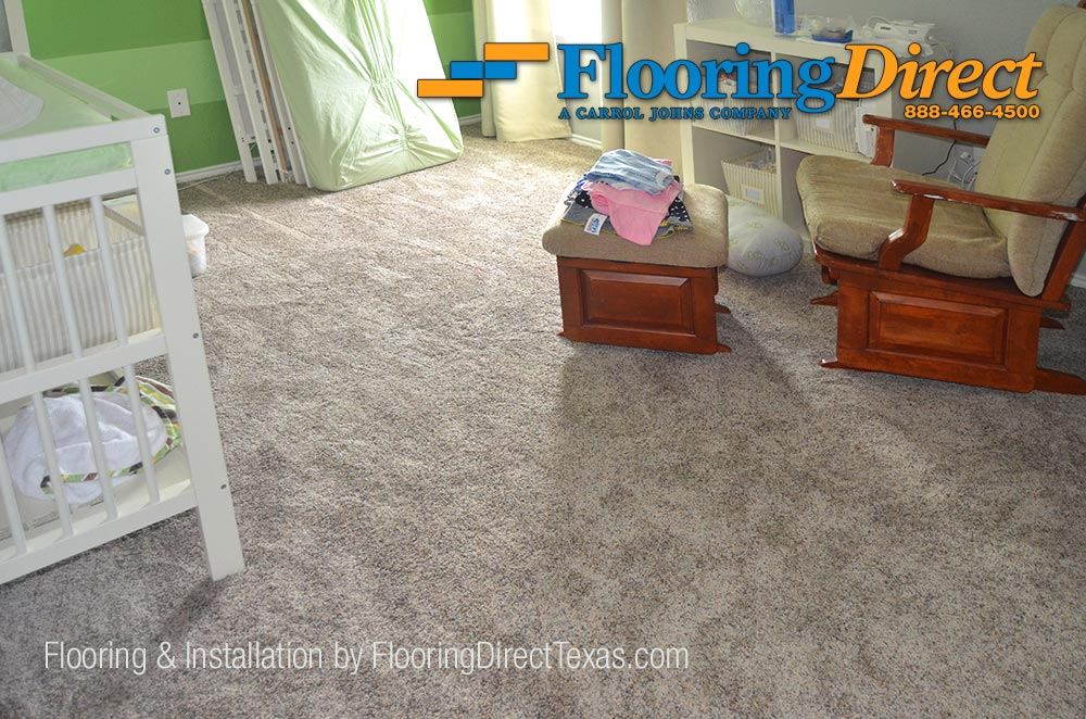 After picture of baby's room with new carpet flooring installed.