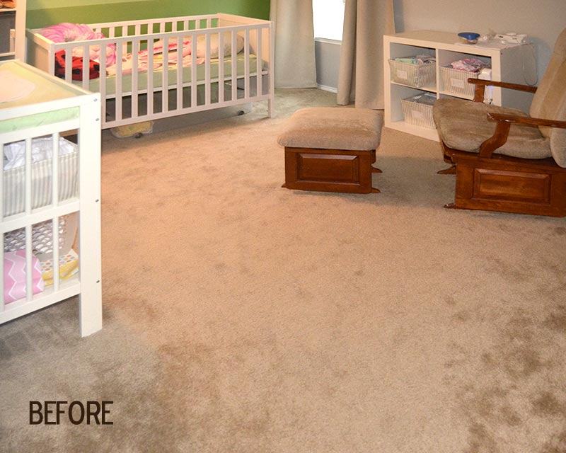 Before picture of baby's room with previous carpeting.